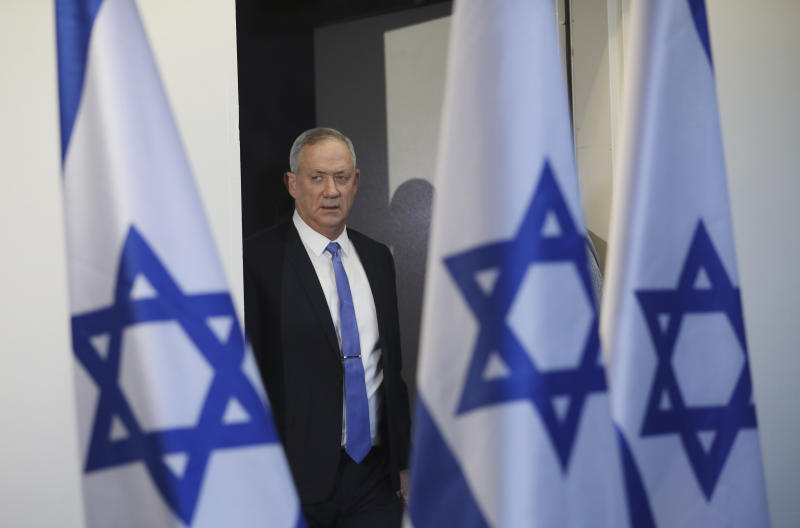 FILE - In this Nov. 20, 2019, file photo, Blue and White party leader Benny Gantz arrives to address media in Tel Aviv, Israel.  A blueprint the White House is rolling out to resolve the decades-long conflict between the Israelis and Palestinians is as much about politics as it is about peace. President Donald Trump said he would likely release his long-awaited Mideast peace plan a little before he meets Tuesday with Israeli Prime Minister Benjamin Netanyahu and his main political rival Benny Gantz. (AP Photo/Oded Balilty, File)