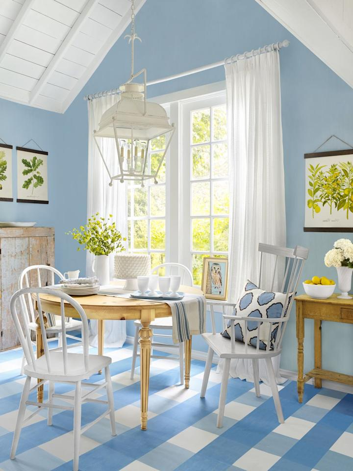 <p>Embrace a classic country blue-and-white color palette from ceiling to floor—literally. In this breakfast nook, plaid painted floors set the tone for the rest of the freshly decorated room. </p>