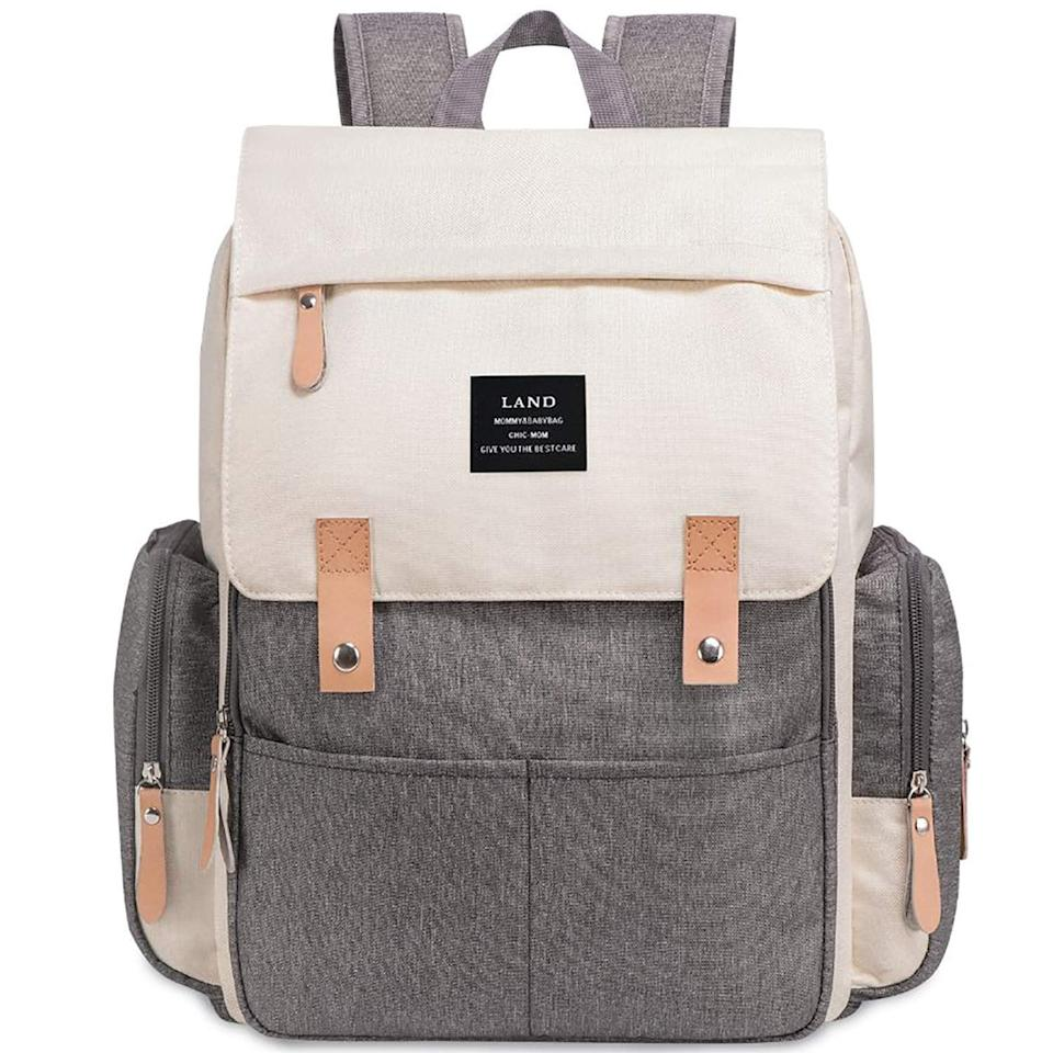 """<p>Carry all of the essentials without getting weighed down thanks to the <a href=""""https://www.popsugar.com/buy/Diaper-Bag-Backpack-Large-Capacity-Insulated-Pockets-424106?p_name=Diaper%20Bag%20Backpack%20With%20Large-Capacity%20Insulated%20Pockets&retailer=walmart.com&pid=424106&price=40&evar1=moms%3Aus&evar9=44483623&evar98=https%3A%2F%2Fwww.popsugar.com%2Ffamily%2Fphoto-gallery%2F44483623%2Fimage%2F45935519%2FDiaper-Bag-Backpack-Large-Capacity-Insulated-Pockets&list1=diaper%20bags%2Cbaby%20showers%2Cbaby%20shower%20gifts%2Cbaby%20shopping%2Cparent%20shopping&prop13=mobile&pdata=1"""" rel=""""nofollow"""" data-shoppable-link=""""1"""" target=""""_blank"""" class=""""ga-track"""" data-ga-category=""""Related"""" data-ga-label=""""https://www.walmart.com/ip/Diaper-Bag-Backpack-with-Large-Capacity-Insulated-Pockets-Attached-Stroller-Straps-Baby-Care-Nappy-Bag-Travel-Knapsack-Changing-Pad/943653330"""" data-ga-action=""""In-Line Links"""">Diaper Bag Backpack With Large-Capacity Insulated Pockets</a> ($40).</p>"""