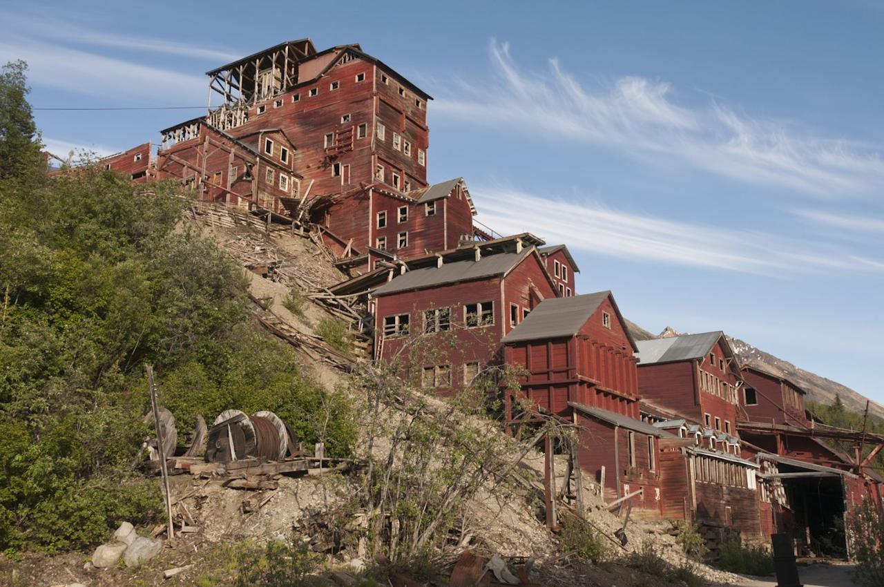 "<p>The mining village of Kennecott was built on the side of the Kennicott Glacier in the early 20th century. From 1911-1938, the mine processed <a href=""https://www.nps.gov/wrst/learn/historyculture/kennecott-mines-national-historic-landmark.htm"" target=""_blank"">nearly $200 million worth of copper</a> and employed approximately 300 people. Around 1920, the small town of McCarthy – fit with a hospital, general store, school, saloons, and recreation hall – sprung up at the base of the mountain to serve the mineworkers and their families. </p><p>By the late 1930s, the Kennecott Copper Corporation was closed down, and many of the families left the area. Today, both the town of McCarthy and the Kennecott mines are open for tours.</p>"