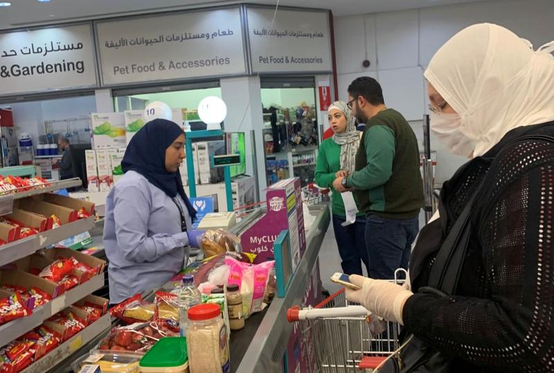 A woman wears a protective face mask inside a Carrefour hypermarket while Egypt ramps up its efforts to slow the spread the coronavirus disease (COVID-19) in Cairo