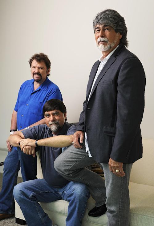 "In this Tuesday, Aug. 13, 2013 photo, Jeff Cook, Teddy Gentry and Randy Owen from the American country music band Alabama pose for a portrait in Nashville, Tenn. Alabama has launched a tour and released a new album this week, ""Alabama & Friends,"" that features duets of the group's biggest hits with top country stars. (Photo by Donn Jones/Invision/AP)"