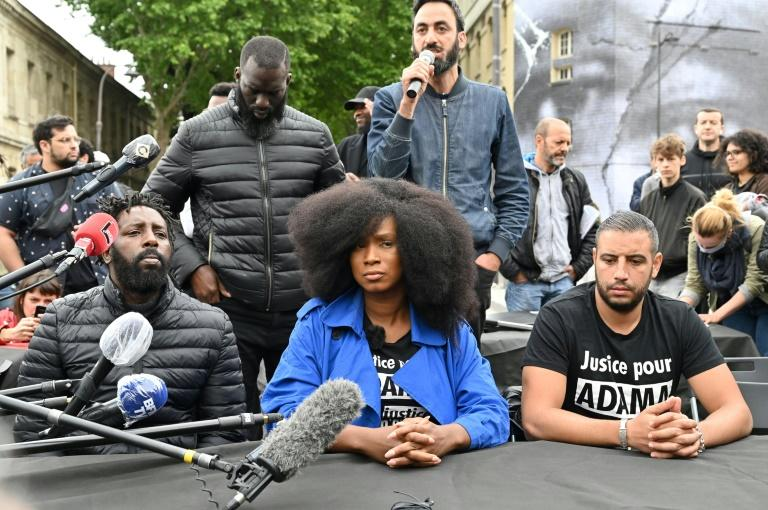 Assa Traore (centre), the sister of Adama Traore, who died in a French police arrest in 2016, at a press conference after a mural to her brother and George Floyd was unveiled in Paris Tuesday