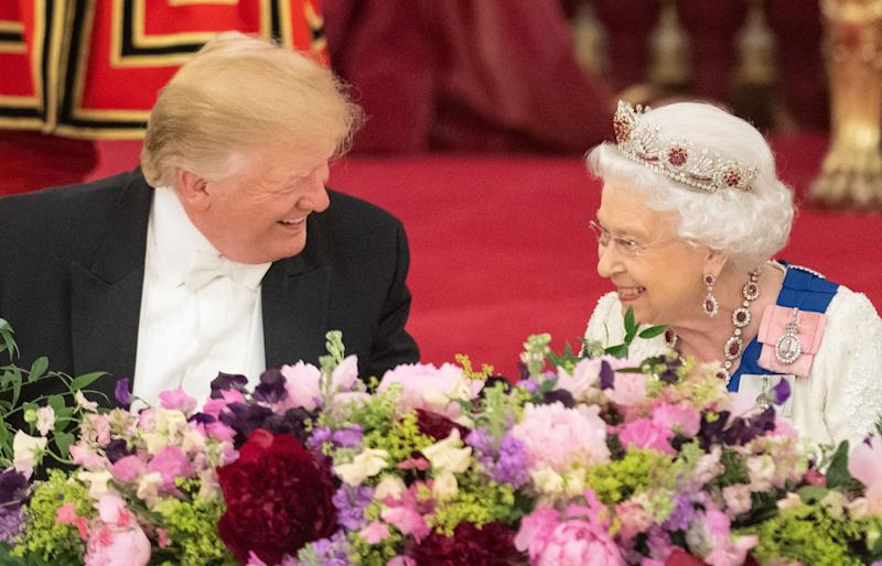 Queen Elizabeth laughs with US President Donald Trump during a State Banquet