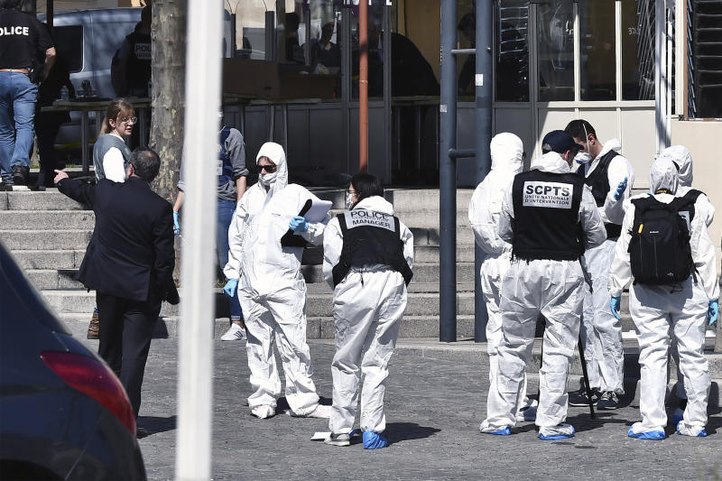 Police officers investigate after a man wielding a knife attacked residents venturing out to shop in the town under lockdown, Saturday April 4, 2020 in Romans-sur-Isere, southern France. The alleged attacker was arrested by police nearby, shortly after the attack. Prosecutors did not identify him. They said he had no documents but claimed to be Sudanese and to have been born in 1987. (AP Photo)