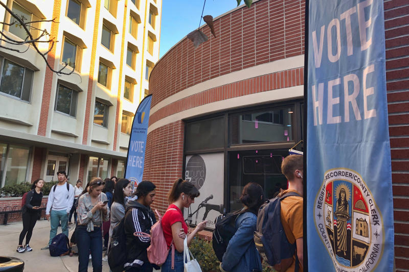 Voters wait on line at a polling station at the University of Southern California on Tuesday, March 3, 2020. Some California voters are waiting in long lines because of technical glitches connecting to the statewide voter database or too many users trying to cast ballots at once. The secretary of state's office said election workers in 15 counties could not connect to the statewide voter registration database on Super Tuesday but that the issues have been resolved. (AP Photo/Stefanie Dazio)