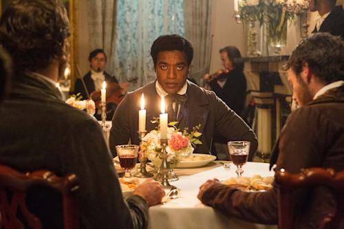 """FILE- In this July 18, 2012, film publicity image released by Fox Searchlight, Chiwetel Ejiofor portrays Solomon Northup in a scene from """"12 Years A Slave."""" Thanks to Northup's memoir, which the film was based on, historians know where Solomon Northup was born, where he lived and where he worked. Much of his life is part of the record but no one knows when and how he died or where he is buried. (AP Photo/Fox Searchlight Films, Jaap Buitendijk, File)"""