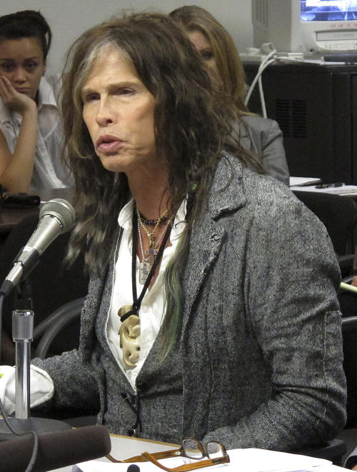 FILE - This Feb. 8, 2013 file photo shows Aerosmith lead singer Steven Tyler testifying on celebrity privacy during a hearing at the Hawaii Capitol in Honolulu. The Hawaii state Senate plans to vote on a bill aimed at protecting celebrities and other public figures from unwanted media attention. The so-called Steven Tyler Act would create a civil violation for people who take photos or videos of others' private moments. (AP Photo/Oskar Garcia, file)