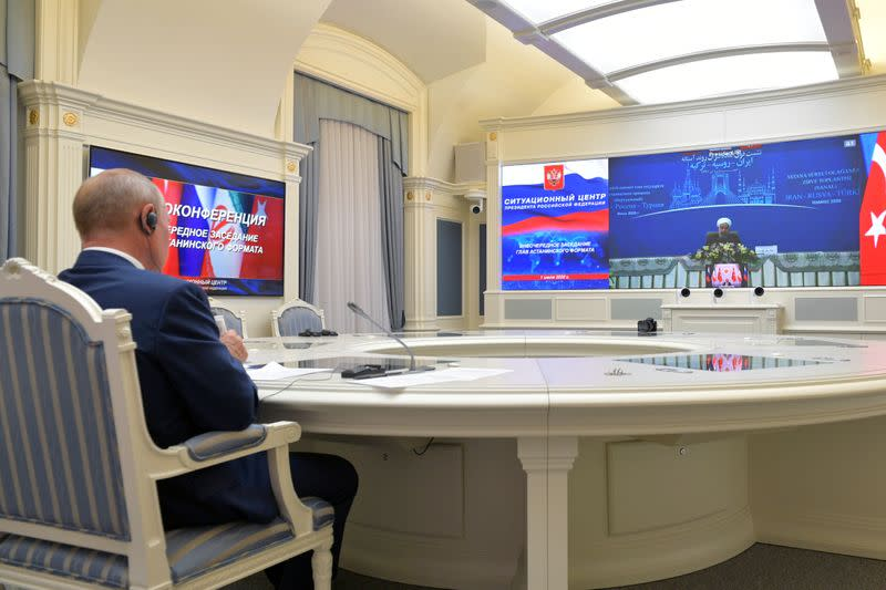 Russia's President Putin speaks with Turkey's President Erdogan and Iran's President Rouhani during a video conference call in Moscow