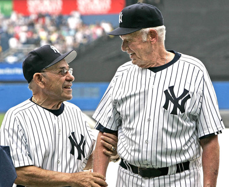 In this hand-out photo released by the New York Yankees, former Yankee Yogi Berra, left, talks with former teammate Don Larsen at the 60th Annual Old-Timer's Day duting MLB baseball at Yankee Stadium in New York. (AP Photo/NY Yankees,HO)