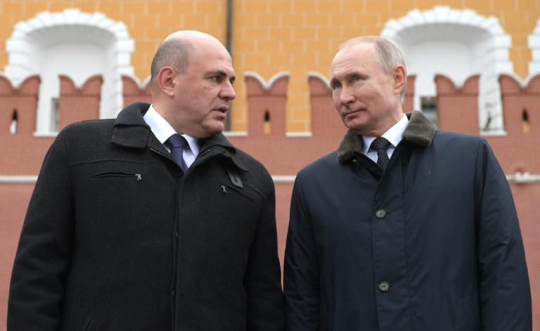 Mishustin with Vladimir Putin in February -- the Russian president has not held any face-to-face meetings for weeks