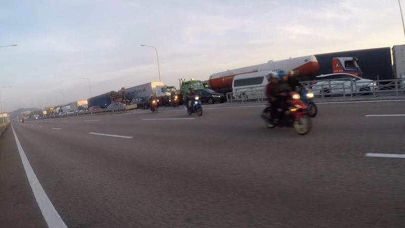 Motorcyclists travelling along the Second Link Crossing. — Picture by Cheo Yee How