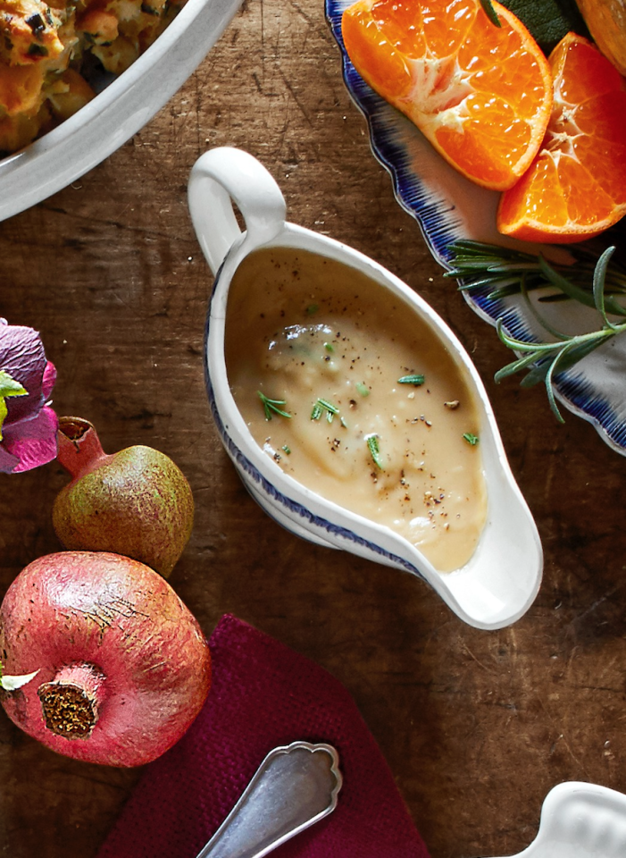 """<p>Healthy shouldn't mean bland! Top your turkey with this rich, flavorful gravy. A little goes a long way.</p><p><strong><a href=""""https://www.countryliving.com/food-drinks/a29131148/white-wine-and-rosemary-gravy-recipe/"""">Get the recipe</a>.</strong></p><p><strong><a class=""""body-btn-link"""" href=""""https://www.amazon.com/Now-Designs-Tommy-Turkey-Gravy/dp/B07V8VXV45/?tag=syn-yahoo-20&ascsubtag=%5Bartid%7C10050.g.33370793%5Bsrc%7Cyahoo-us"""" target=""""_blank"""">SHOP GRAVY BOATS</a><br></strong></p>"""