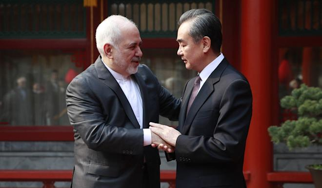 Iranian Foreign Minister Mohammad Javad Zarif (left) and his Chinese counterpart Wang Yi during a meeting in Beijing on February 19, 2019. Photo: EPA-EFE