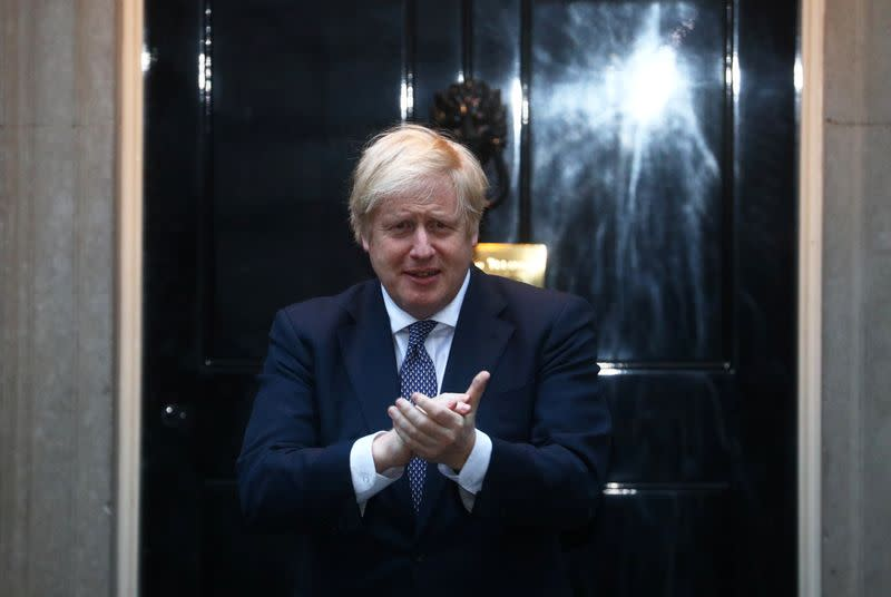 Newly recovered UK leader Johnson joins applause for coronavirus carers
