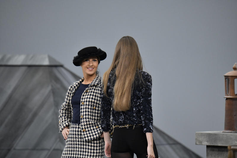 Gigi Hadid approaches the woman during the finale and escorted her off the catwalk, because few minutes before a spectator inserted herself among the lineup of models during the finale, identified as Marie Benoliele, best known as Marie S'Infiltre a youtuber, during the Chanel Ready to Wear Spring/Summer 2020 fashion show as part of Paris Fashion Week on October 01, 2019 in Paris, France.