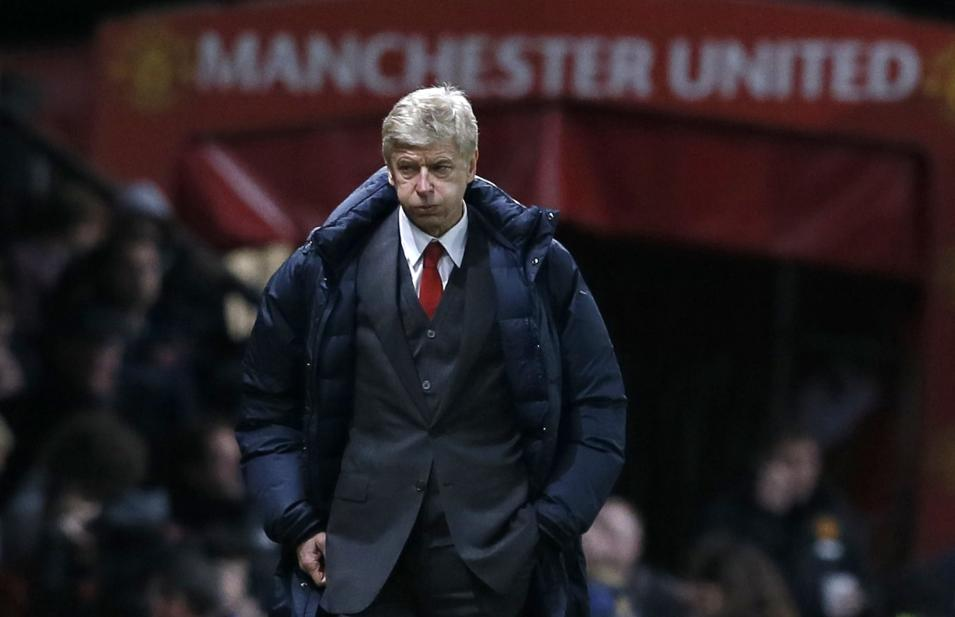 Arsenal's manager Wenger reacts during their English Premier League soccer match against Manchester United in Manchester