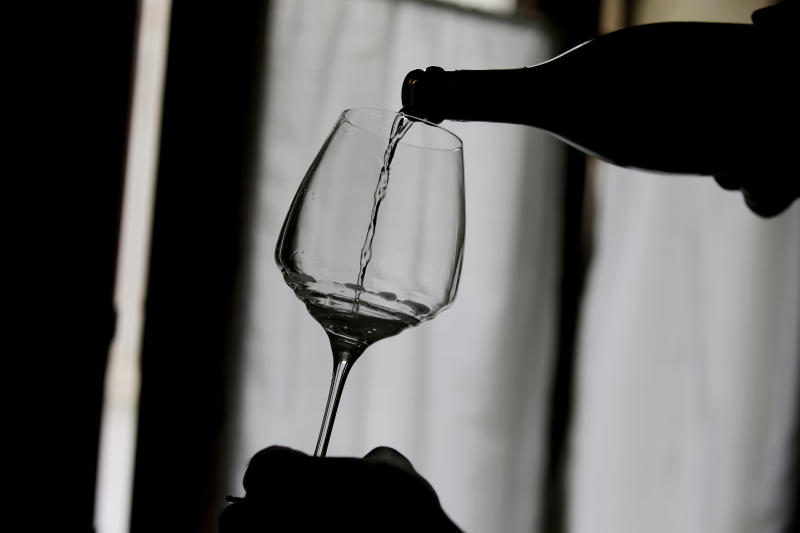 FILE - This Oct. 15, 2018, file photo shows Prosecco wine poured into a glass during a wine tasting at the Case Paolin farm in Volpago del Montello, Italy. Doctors are reporting that people infected with the pandemic virus may lose their sense of smell and perhaps taste. Virus infection is already a known cause of smell loss, and in some cases it can be permanent. But in cases of the pandemic virus, it looks more like a temporary effect. (AP Photo/Luca Bruno, File)