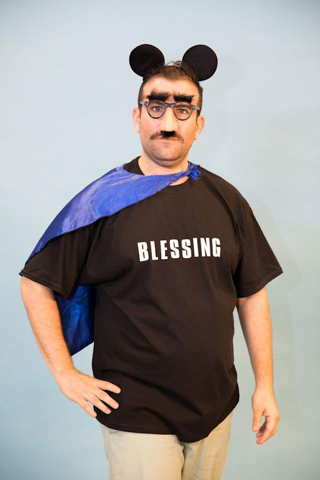 """<p>Everyone at the party will count their blessings as soon as you walk through the door. Spell out """"blessing"""" with iron-on letters, and then accessorize with a cape, fake mustache, and plastic glasses. </p><p><a class=""""body-btn-link"""" href=""""https://www.amazon.com/dp/B00412WY5C/?tag=syn-yahoo-20&ascsubtag=%5Bartid%7C10055.g.28089320%5Bsrc%7Cyahoo-us"""" target=""""_blank"""">SHOP NOSE AND MUSTACHE GLASSES</a></p><p><strong>RELATED: </strong><a href=""""https://www.goodhousekeeping.com/holidays/halloween-ideas/g2750/easy-last-minute-halloween-costumes-diy/"""" target=""""_blank"""">Last-Minute Costumes You Can Easily DIY </a></p>"""