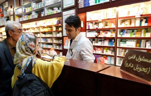 Iranians shop at a drugstore at the Nikan hospital in Tehran on September 11, 2018 before the International Court of Justice ruled on October 3 that the US should suspend its sanctions and allow the free exports of medicines