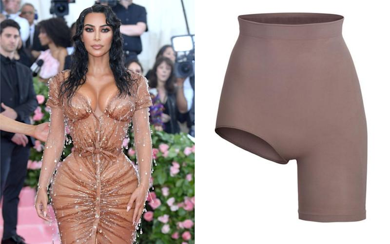 Kim Kardashian's undergarment collection features a pair of asymmetric cycling shorts [Photo: Getty/Skims]