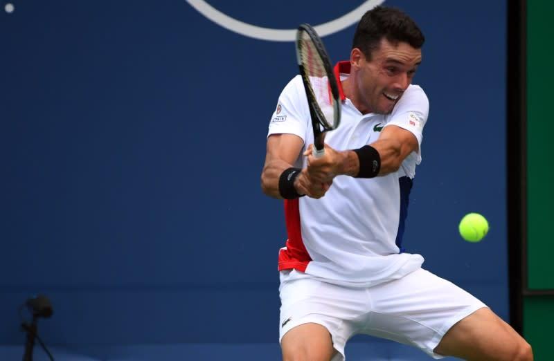 Tennis: Bautista Agut finds way past tricky Kecmanovic