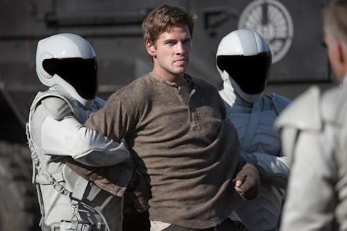 """This image released by Lionsgate shows Liam Hemsworth as Gale Hawthorne in a scene from """"The Hunger Games: Catching Fire."""" (AP Photo/Lionsgate, Murray Close)"""