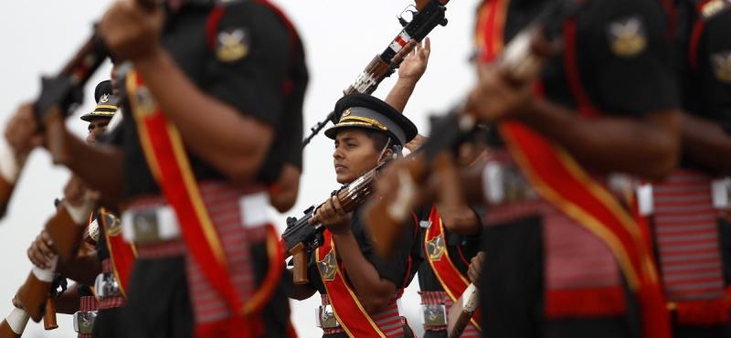 """File photo: Indian cadets perform the """"Continuity Drill"""" with rifles at a combined display with trainees from the Officers Training Academy (OTA) in Chennai, India, Friday, Sept. 11, 2015. The parade is the culmination of a year-long training for the men and women who will be inducted as officers in the Indian Army. (AP Photo/Arun Sankar K.)"""