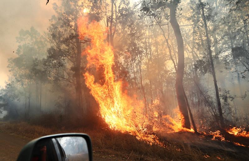 Firefighters battle bushfires in Busbys Flat, northern NSW, Wednesday, October 9, 2019. (AAP Image/Jason O'Brien) NO ARCHIVING