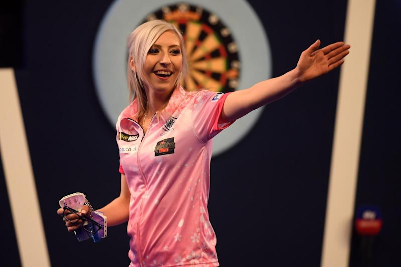 History maker   Fallon Sherrock reacts after winning her 1st round game against Ted Evetts: Alex Davidson/Getty Images
