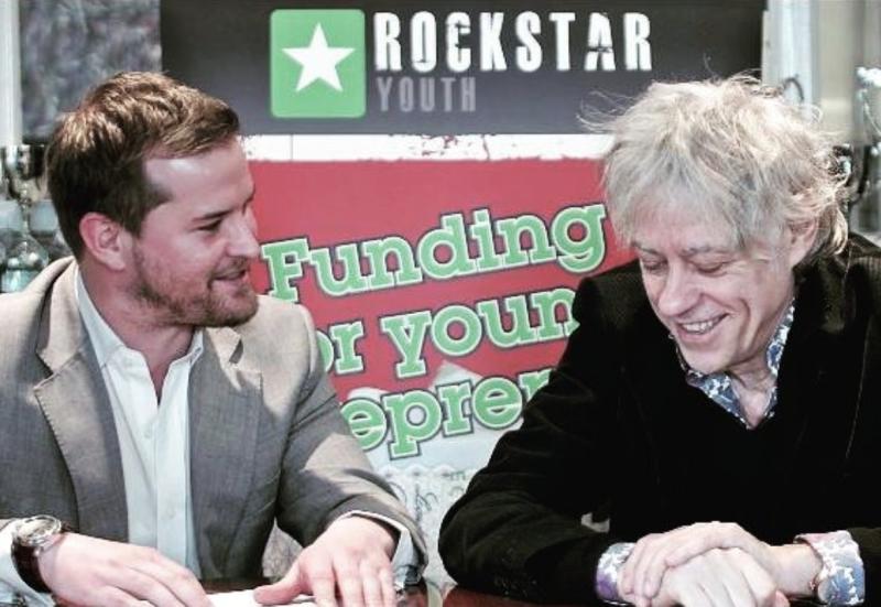 Jon Pfahl (left) engaging with Bob Geldof at a Rockstar event.