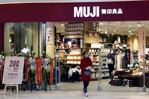 A shopper walks outside a newly opened Muji store at a shopping mall in Hangzhou in eastern Zhejiang province in late 2016. Photo: Reuters