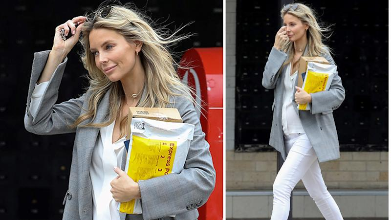 Pregnant Jennifer Hawkins pictured going to the post office