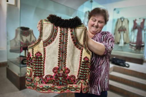 """Dressmakers from Romania's northwestern Bihor region were surprised to see an embroidered folk coat in a collection by Dior which looked strikingly similar to the """"cojocel binsenesc"""" waistcoat their region has been producing for around a century"""