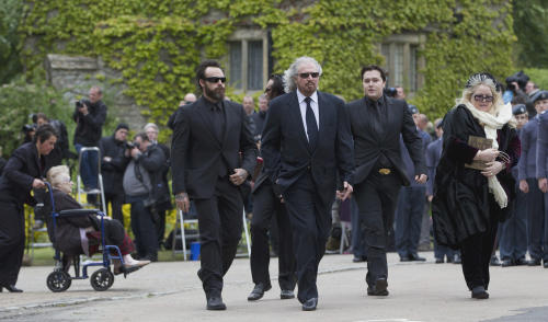 Barry Gibb, second, left and Dwina Gibb, right, walk behind the funeral procession of Robin Gibb as they walk from the family home to St Mary's Church in Thame, England, Friday, June 8, 2012. Robin Gibb a member of the iconic Bee Gees pop group died May 20, after a long battle with cancer.(AP Photo/Alastair Grant)