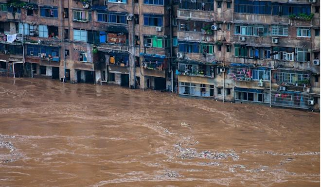 Floods strike a residential area in Chongqing in southwest China on July 1. Photo: Xinhua