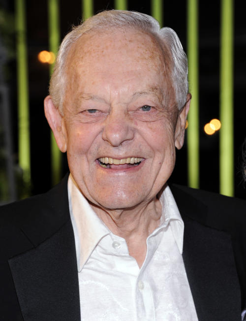 FILE - In this Nov. 8, 2011, file photo, Bob Schieffer arrives at the 59th Annual BMI Country Awards in Nashville. Beneath Schieffer's Southern charm is the tough spine of someone used to dealing with politicians. The moderator of Monday's final presidential debate will need it, because it has been open season on the other journalists who have done that job this campaign. Thanks to a bitter campaign rivalry, thriving partisan media outlets and the growth of social media, debate moderator is approaching baseball umpire on the scale of thankless jobs. (AP Photo/Evan Agostini, File)