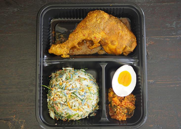 The 'nasi ulam' comes in a container with compartments