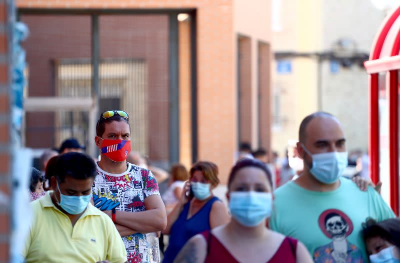 Spain's daily COVID-19 infections retreat from peaks