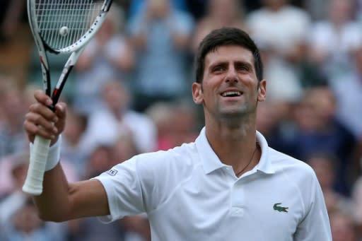 Moving on: Novak Djokovic celebrates after beating Karen Khachanov to reach the quarter-finals