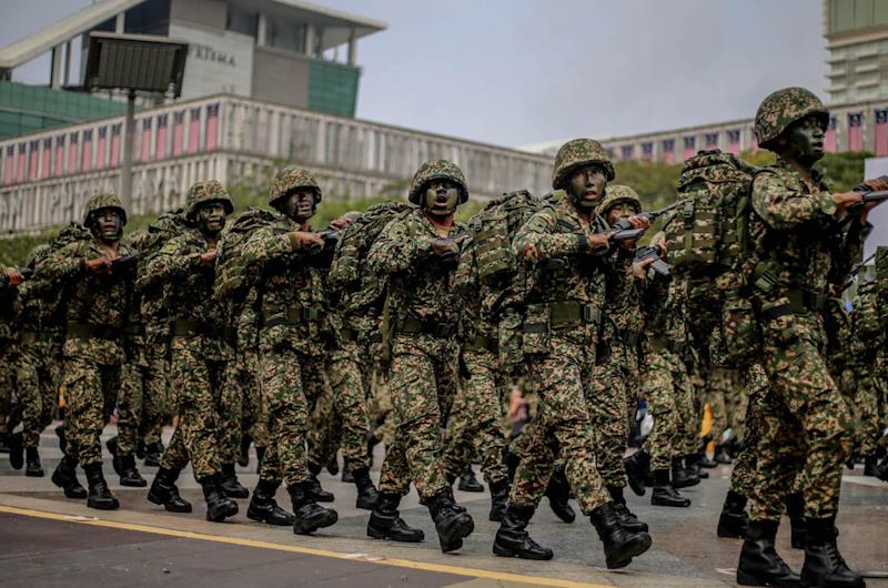 Malaysian Armed Forces personnel march during a National Day rehearsal in Putrajaya August 29, 2019. — Picture by Firdaus Latif