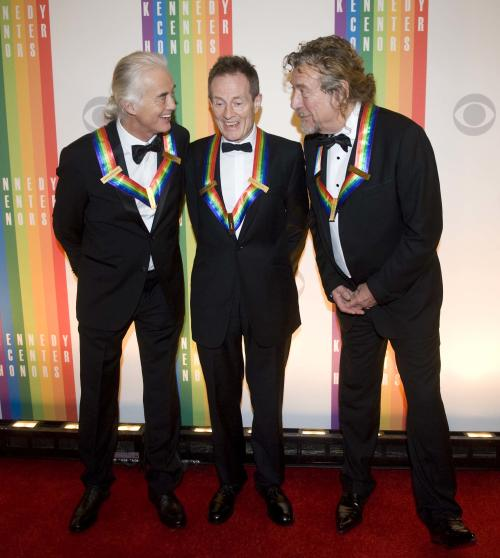 2012 Kennedy Center Honorees and members of the band Led Zeppelin, from left, Jimmy Page, John Paul Jones, and Robert Plant chat on the red carpet after arriving at the Kennedy Center for the Performing Arts for the 2012 Kennedy Center Honors Performance and Gala Sunday, Dec. 2, 2012 at the State Department in Washington. (AP Photo/Kevin Wolf)