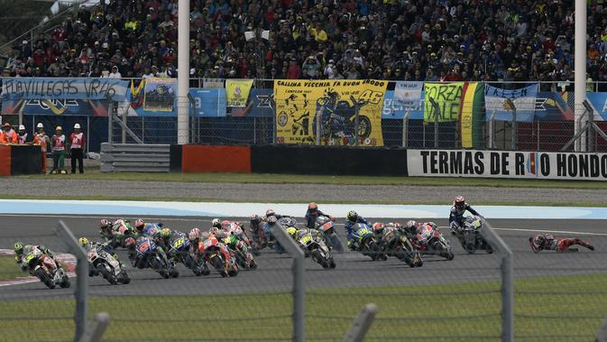 Ilustrasi balapan MotoGP. (JUAN MABROMATA / AFP)