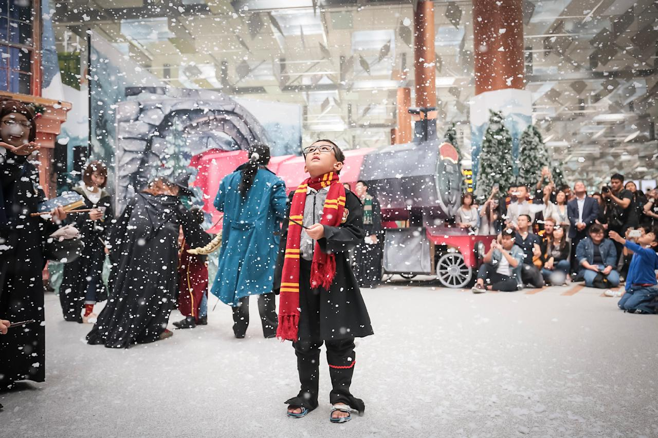 <p>Sitting on the Equator, Singapore is famously hot and humid year round. But at Changi, young fans are enthralled by the snow at a wintry Hogsmeade Village-inspired setup at Terminal 3 Departure Hall. Picture: Supplied, Changi Airport. </p>