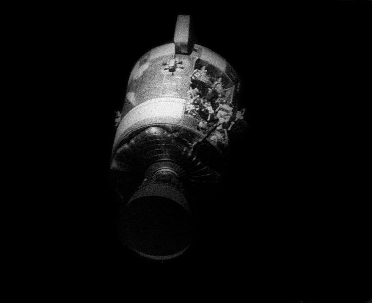 """This April 17, 1970 photo made available by NASA shows the severely damaged Apollo 13 service module after separation from the lunar module/command module. An entire panel on the service module was blown away by the explosion of an oxygen tank. The damage forced the Apollo 13 crew members to use the lunar module as a """"lifeboat."""" The lunar module was jettisoned just prior to Earth re-entry by the command module. (NASA via AP)"""