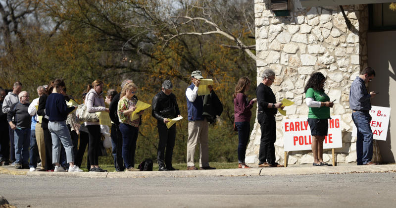 Voters wait in line at an early polling site in San Antonio, Friday, Feb. 28, 2020. Friday is the final day for early voting and Election Day is Tuesday. (AP Photo/Eric Gay)