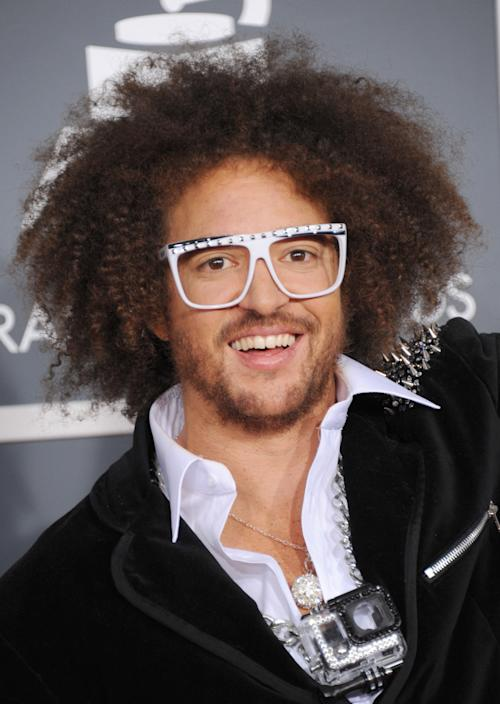 Stefan Kendal Gordy, of musical group LMFAO, arrives at the 55th annual Grammy Awards on Sunday, Feb. 10, 2013, in Los Angeles. (Photo by Jordan Strauss/Invision/AP)