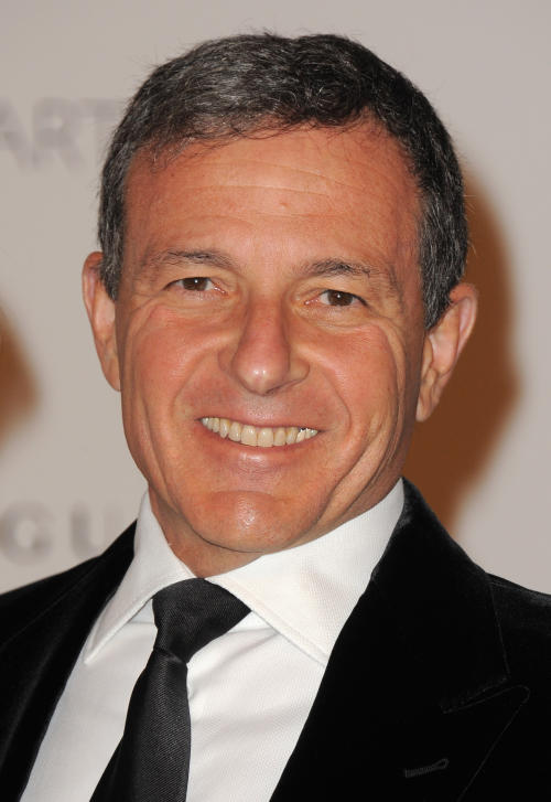 """FILE - In this Nov. 5, 2011 file photo, LACMA trustee Bob Iger arrives at LACMA's Art And Film Gala Honoring Clint Eastwood And John Baldessari at LACMA, in Los Angeles, Calif. Walt Disney Co. CEO Iger says screenwriters Larry Kasdan and Simon Kinberg are both working on standalone """"Star Wars"""" movies not part of a new planned trilogy. Iger told CNBC on Tuesday, Feb. 5, 2013, that the standalone movies will be based on """"great 'Star Wars' characters that are not part of the overall saga."""" (Photo by Jordan Strauss/Invision/AP Images, File)"""