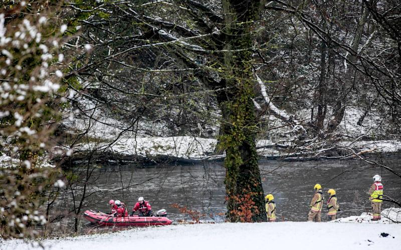 Rescue workers search for the teenager in the River Wear - NNP