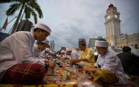 Malaysian Muslim students break their fast at Merdeka Square in Kuala Lumpur in 2017 - Credit: Vincent Thian